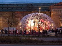 Santa Claus factory in Budapest. In the beautifully illuminated Santa Claus factory - a glass dome set up next to Heroes' Square - Red Cross volunteers are Stock Photos