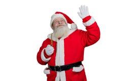 Santa Claus faisant le geste sur le fond blanc Images libres de droits