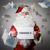 Santa Claus and falling Euro banknotes. One million Euro concept Royalty Free Stock Photos