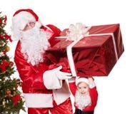 Santa Claus familj med barnet. arkivbild