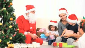 Santa Claus with a family Royalty Free Stock Images