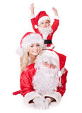 Santa claus family with child. Stock Photos