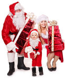Santa claus family with child holding gift box.. Santa Claus family with child holding stack gift box. Isolated Stock Photo