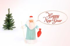 Santa Claus and Christmas tree in the snow. Postcard royalty free stock photos