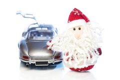 Santa Claus or Father Frost with old retro car Stock Photos