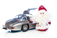 Santa Claus or Father Frost with old retro car Stock Photography