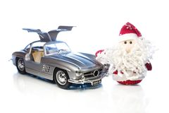 Santa Claus or Father Frost with old retro car Stock Images