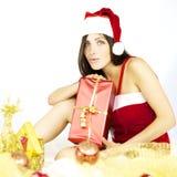 Santa Claus feliz con el presente del rojo listo para la Navidad Imágenes de archivo libres de regalías