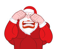 Santa Claus fights. Father Christmas beats fists. Old man knuckl Stock Photos