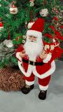 Santa Claus figure and decorated Christmas tree royalty free stock photos