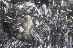 Santa Claus figure on silver sparkles backgraund Stock Photo