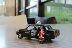 Santa claus figure by taxi Stock Photo