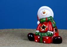 Santa Claus figurine on a blue background.  Stock Photo