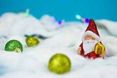 Santa Claus figurine. On blue background with Christmas ornaments Royalty Free Stock Photo