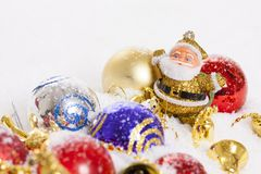Santa Claus figurine and Christmas balls Royalty Free Stock Images