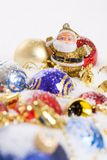 Santa Claus figurine and Christmas balls Royalty Free Stock Image