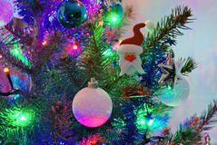 Santa Claus figurine in the Christmas tree royalty free stock photography