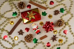 Santa Claus figurine, gift, cinnamon, star anise, pine cones and royalty free stock photography
