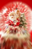 Santa claus figurine on a glass snowing ball Royalty Free Stock Photo