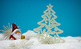 Santa Claus figurine. With white christmas tree Stock Photography