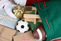 Santa Claus Filling His Bag Stock Image