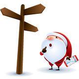 Santa Claus finding location. With his smart phone Stock Photography