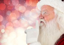 Santa claus with finger on lip Stock Photography