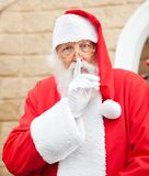 Santa Claus With Finger On Lips Royalty Free Stock Images