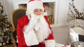 Santa Claus finishing writing and checking his letter to a kid. Top view. Professional shot on Lumix GH4 in 4K resolution. You can use it e.g. in your Royalty Free Stock Images