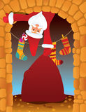 Santa Claus in the fireplace. On Christmas eve Stock Images