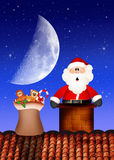 Santa Claus in the fireplace Stock Photos
