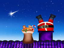 Santa Claus in the fireplace Stock Images