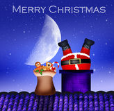 Santa Claus in the fireplace Royalty Free Stock Photography
