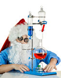 Santa Claus with flasks Stock Photography