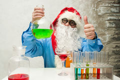 Santa Claus with flasks Royalty Free Stock Image