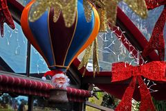 Santa Claus flies on a colorful balloon. Decoration of the street in Haifa for the holidays and the New Year. stock photos