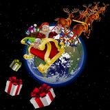Santa Claus flies by planet earth Stock Photo