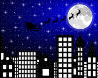 Santa Claus flies reindeer in harness over night city Royalty Free Stock Image
