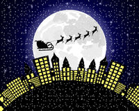 Santa Claus flies reindeer in harness over night city Royalty Free Stock Photos