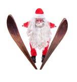 Santa Claus flies on skis stock image