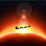 Santa Claus flies into space Royalty Free Stock Photos