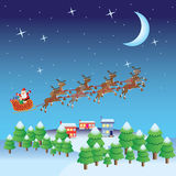 Santa Claus fly in sleigh with deers. Stock Photo