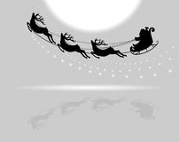 Santa Claus flying with deer Stock Photos