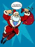 Santa Claus is flying with gifts like a superhero Stock Photos