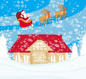 Santa Claus flying over city Stock Photo