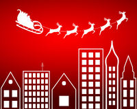 Santa Claus flying over the city Royalty Free Stock Photo