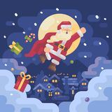 Santa Claus flying over a mountain village in a superhero cape Stock Photography
