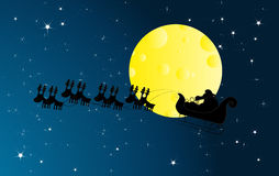 Santa Claus flying over a nighttime sky Stock Image