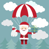 Santa Claus flying with a parachute with presents in the sky. Ve Royalty Free Stock Photo