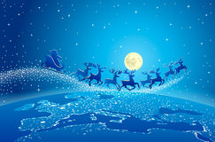 Santa Claus Flying Reindeer World Stars. Santa Claus in his sleigh with reindeer flying in a dark blue sky filled with stars over the world on Christmas Eve Royalty Free Stock Images